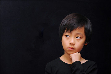 Young boy thinking ( dark background )