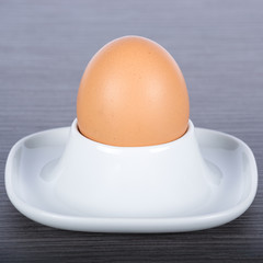 Closeup of an egg and a porcelain egg cup