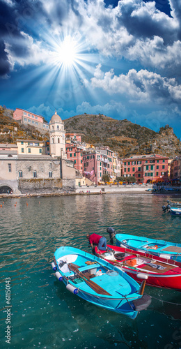 Colorful boats in the quaint port of Vernazza, Cinque Terre - It