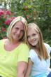 Friendly blond teenager with her mother
