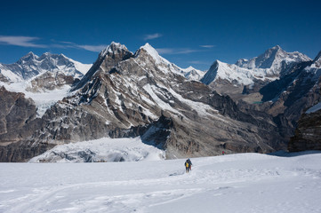 Mountaineers walking on snow in Himalayas of Nepal