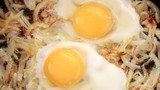 fried eggs with onions