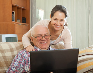 man and woman  with  laptop
