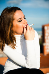 Portrait of a beautiful smoking girl