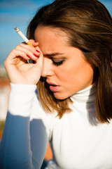 Portrait of a beautiful smoking girl
