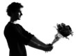 young man silhouette offering flowers bouquet