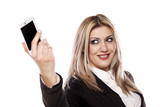 pretty business woman taking selfie with her smart phone poster