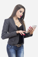 Young beautiful business woman with tablet in office