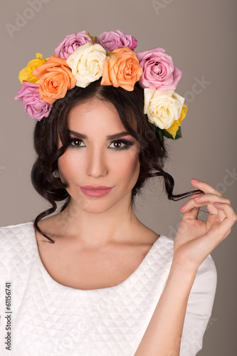 studio portrait of a beautiful woman with wreath
