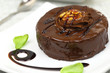 Chocolate dessert with decoration on white plate