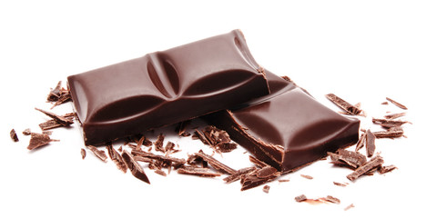 Dark chocolate bars stack with crumbs isolated on a white
