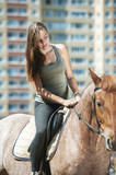 beautiful young woman on horseback
