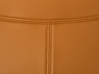 T shape stitched tan leather.