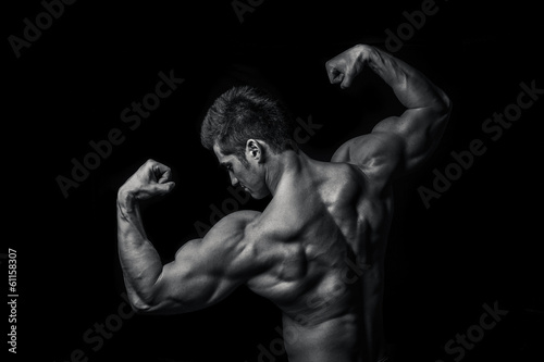 Man with muscular torso isolated on black background,  male tors - 61158307