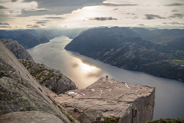 Silhouettes of two people on Pulpit Rock Preikestolen.