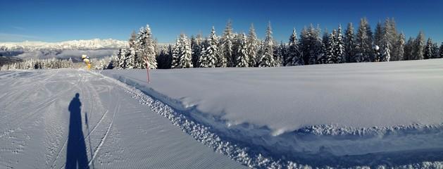 fotografo su pista da sci