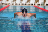 Professional swimmer in swimming pool - butterfly  stroke