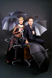Couple doing umbrella trick
