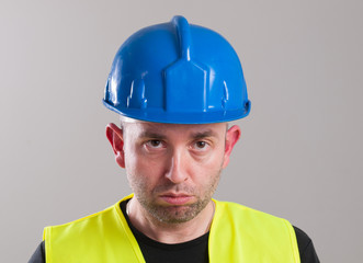Portrait of a sad worker