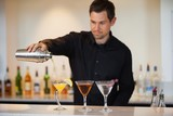 Bartender pouring cocktails