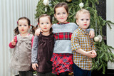 Cute children near the decorated christmas tree