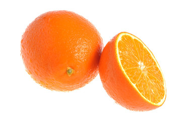 A half and a whole orange covered by water drops isolated on whi