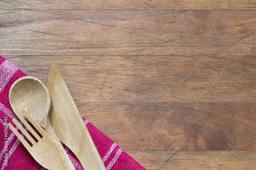 Wooden cutlery on cutting board abstract food background