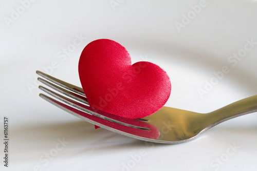 Heart on the fork abstract sign symbol