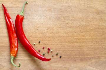 Red hot chili Peppers on wooden board abstract background