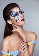 Makeup. Manicured nails. Fashion face art portrait. Beautiful mo