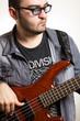 Playing bass guitar