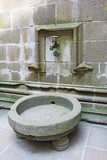Water tap in abbey Mont Saint Michel