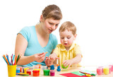 mother and kid plasticine modeling together isolated on white
