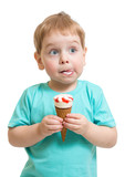 Funny boy eating icecream isolated on white
