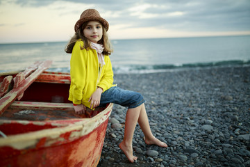 Beach, boat and girl - Portrait of  girl on the beach