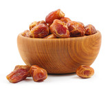 Wooden bowl full of dates