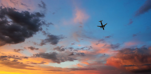 An Airliner Cruises Through a Sunset Sky