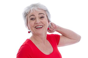Gesicht einer älteren Frau freigestellt mit Falten
