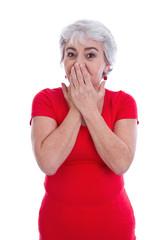Ältere Frau überrascht, ängstlich oder panisch isoliert in Rot