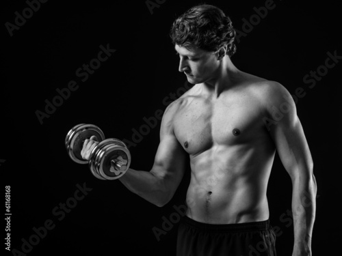 Attractive man doing bicep curls
