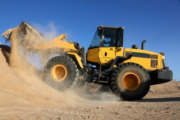 Bulldozer Working with Sand