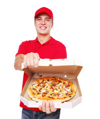 Pizza delivery courier in red uniform offering the pizza in box
