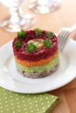 Herring appetizer with beetroot, carrot and avocado