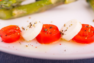 Caprese salad mixed with pepper and olive oil