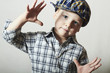 child. funny little boy. close-up.plaid shirt. kid in cap