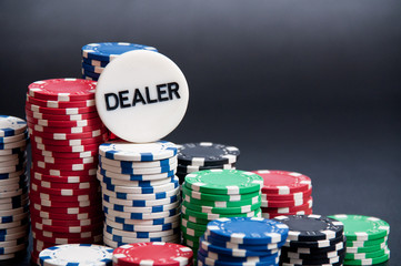 Casino chips, cards, dice and Dealer on top