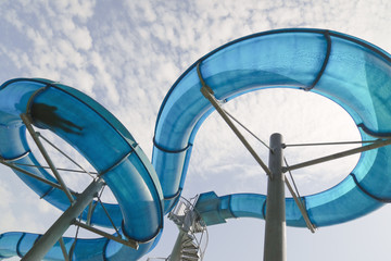 Man's silhouette in water slide