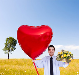 boy with red heart balloon isolated on white background