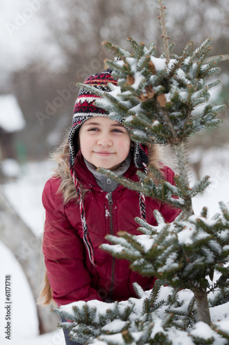 Portrait of a little girl and spruce