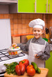 boy chef is cooking on the kitchen
